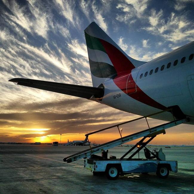 Emirates A330 sunset in Muscat, Oman